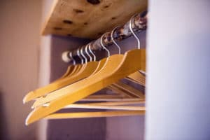 Clothes hangers homemade with river wood of Val Chisone